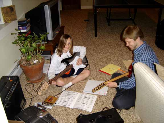 Students of all ages enjoy playing guitar